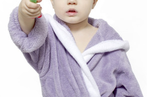 boy holding toothbrush