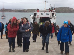 Pre-teens walking off the boat to Iona