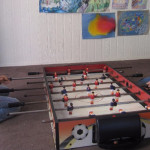 kids playing table soccer